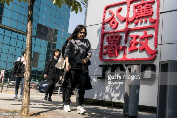 Pedestrians walk past the Hong Kong Independent Commission Against Corruption headquarters in Hong Kong China on Monday Dec 11 2017 Five months after...