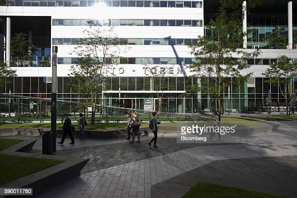 Pedestrians walk past the Itotoren office tower in the Zuidas business district of Amsterdam Netherlands on Monday Aug 15 2016 The Dutch city a...