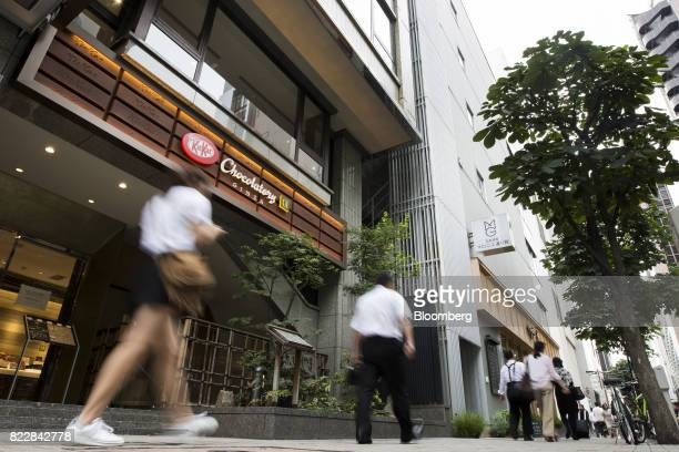 Pedestrians walk past the KitKat Chocolatory Ginza store operated by Nestle SA in Tokyo Japan on Monday July 24 2017 Recent offerings in KitKat...