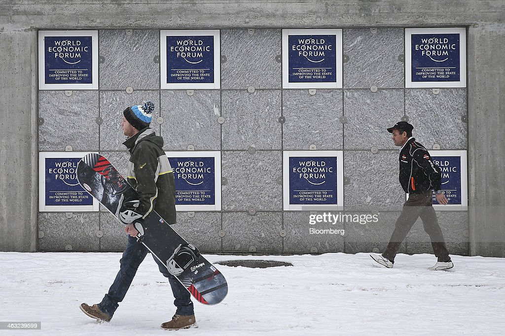 Pedestrians walk past the Kongress Zentrum, or Congress Center, the venue for the World Economic Forum (WEF) in Davos, Switzerland, on Friday, Jan. 17, 2014. Next week the business elite will gather in the Swiss Alps for the 44th annual meeting of the World Economic Forum (WEF) in Davos for the five day event which runs from Jan. 22-25. Photographer: Simon Dawson/Bloomberg via Getty Images