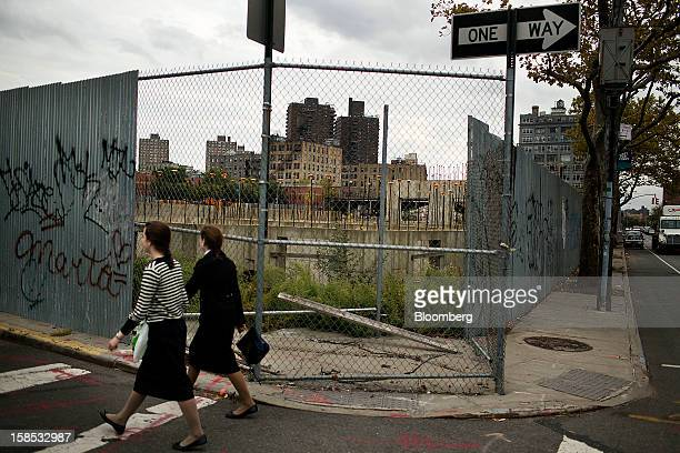 Pedestrians walk past the lot at 421 Kent Ave in the Brooklyn borough of New York US on Monday Oct 15 2012 Xinyuan Real Estate Co's acquisition of a...