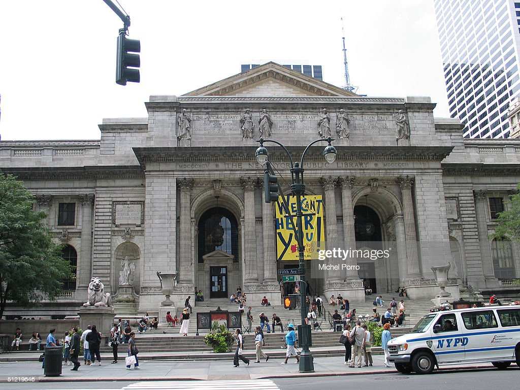 Pedestrians walk past the main building of the New York Public Library August 25 2004 in New York City New York City will host the Republican...