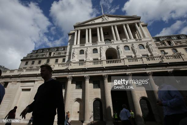 Pedestrians walk past the main entrance of The Bank of England in the City of London on July 31 2017 Lastminute talks with staff at the Bank of...