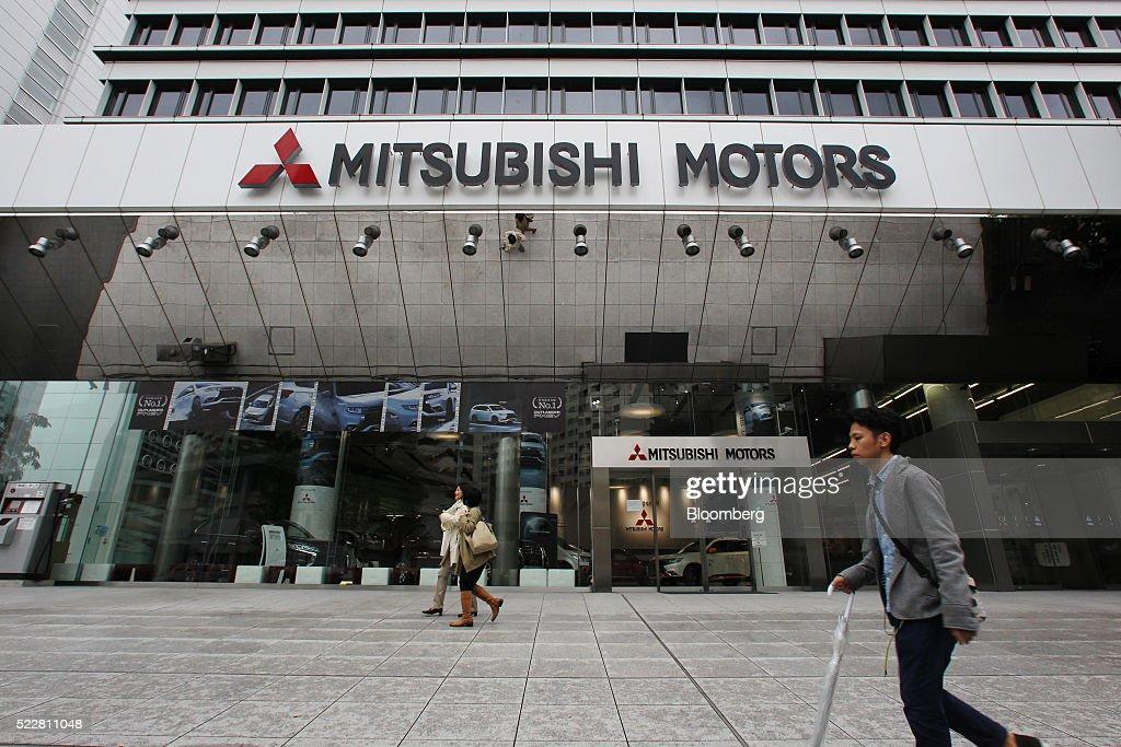 Pedestrians walk past the Mitsubishi Motors Corp headquarters in Tokyo Japan on Thursday April 21 2016 Mitsubishi Motors Corps disclosure that it...
