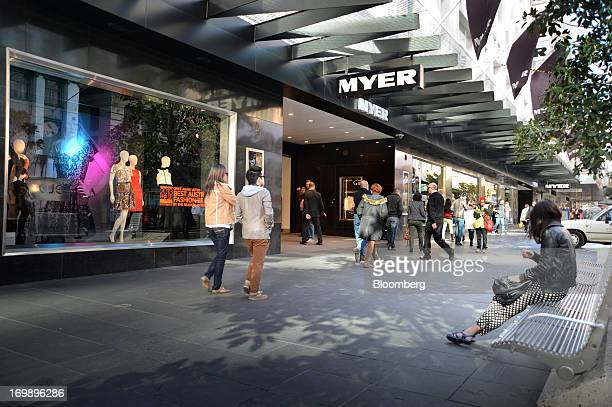 Pedestrians walk past the Myer Holdings Ltd department store on Bourke Street Mall in central Melbourne Australia on Sunday June 2 2013 The...