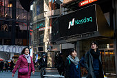 Pedestrians walk past the NASDAQ MarketSite on March 2 2015 in New York City The NASDAQ composite climbed over 5000 points for the first time in 15...