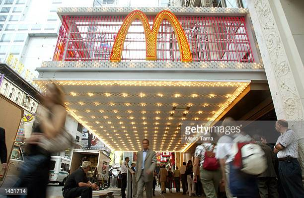 Pedestrians walk past the newlyopened McDonald's restaurant near Times Square September 25 2002 in New York City The 17500 square foot restaurant is...