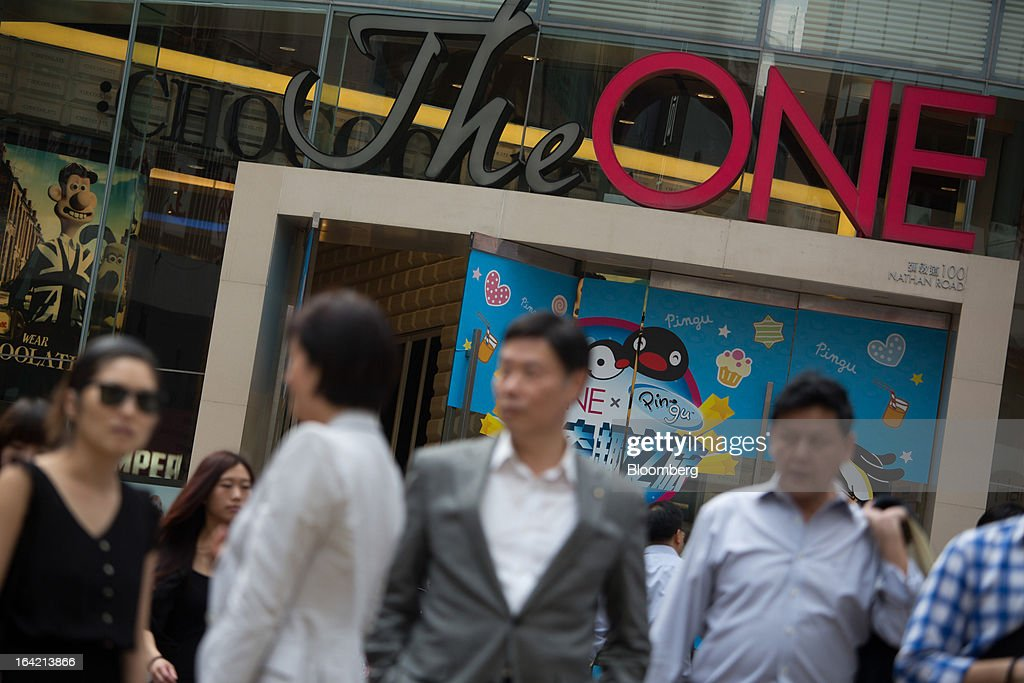 Pedestrians walk past The One shopping mall, operated by Chinese Estates Holdings Ltd., in the Tsim Sha Tsui district of Hong Kong, China, on Wednesday, March 20, 2013. Hong Kong's GDP expanded 2.5 percent last quarter from a year earlier, the most in a year, an end to what was the weakest annual expansion since 2009. Photographer: Lam Yik Fei/Bloomberg via Getty Images