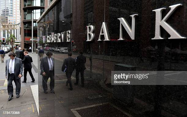 Pedestrians walk past the Reserve Bank of Australia headquarters in the central business district of Sydney Australia on Monday July 15 2013 While...