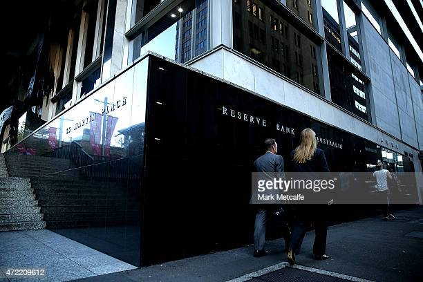 Pedestrians walk past the Reserve Bank of Australia headquarters on May 5 2015 in Sydney Australia Forecasters are predicting the Reserve Bank of...