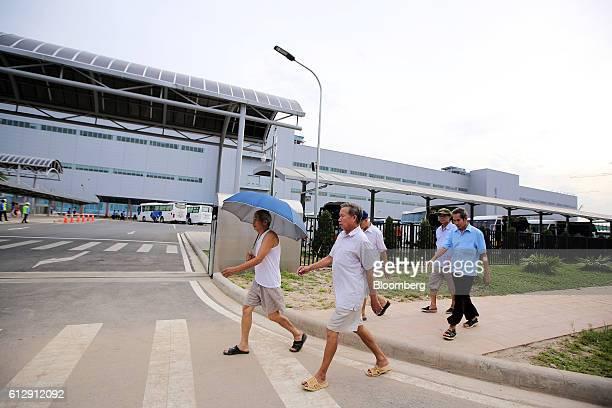 Pedestrians walk past the Samsung Electronics Vietnam Co Plant at Yen Phong Industrial Park in Bac Ninh Province Vietnam on Thursday Sept 1 2016...