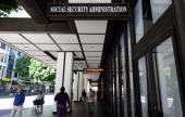 Pedestrians walk past the Social Security Administration office in downtown Los Angeles on October 1 2013 in California US monuments closed offices...