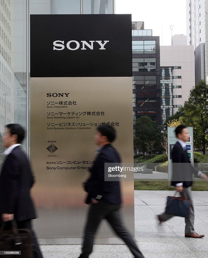 Pedestrians walk past the Sony Corp. headquarters in Tokyo, Japan, on Thursday, Nov. 1, 2012. Sony, Japan's biggest consumer-electronics exporter, unexpectedly posted its seventh straight quarterly loss on falling demand for its TVs as consumers flock to Apple Inc. and Samsung Electronics Co. devices. Photographer: Tomohiro Ohsumi/Bloomberg via Getty Images
