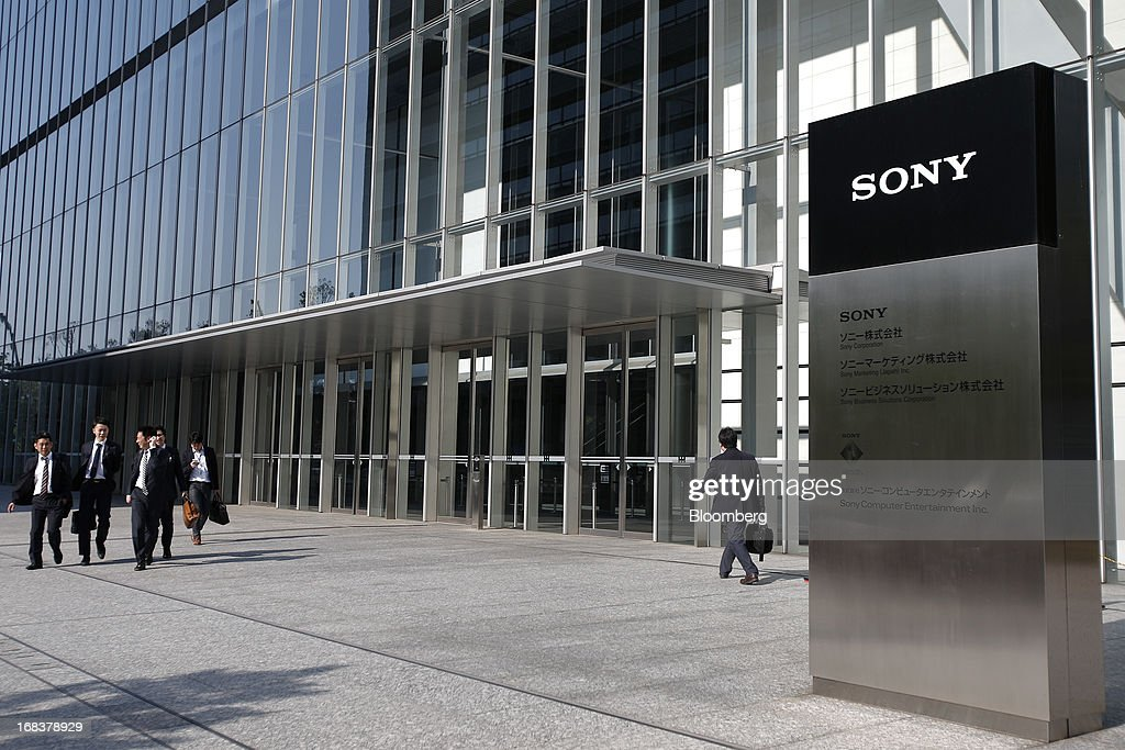 Pedestrians walk past the Sony Corp. headquarters in Tokyo, Japan, on Thursday, May 9, 2013. Sony forecast annual profit that missed analyst estimates as Chief Executive Officer Kazuo Hirai counts on new Xperia smartphones and Bravia TVs to regain market share from Samsung Electronics Co. Photographer: Kiyoshi Ota/Bloomberg via Getty Images