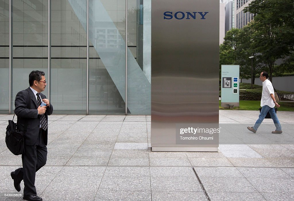 Pedestrians walk past the Sony Corp. headquarters on June 29, 2016 in Tokyo, Japan. Sony announced its mid-range business strategy plan from FY2015 through 2017 today.