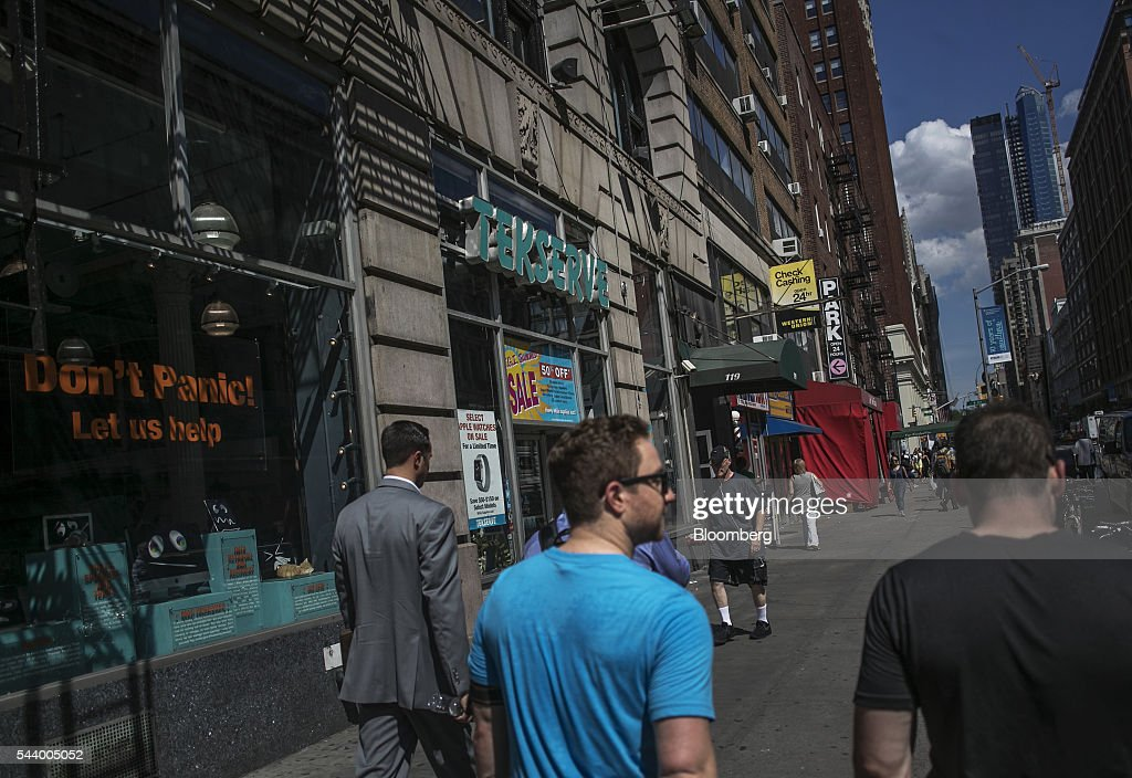 Pedestrians walk past the Tekserve store on 23rd Street in New York, U.S., on Thursday, June 30, 2016. New York City's original Apple repair store, Tekserve, is closing, succumbing to competition and rising rents after almost 30 years of servicing computers and providing technical support to local residents. Photographer: Victor J. Blue/Bloomberg via Getty Images