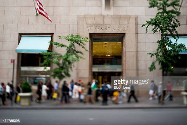 Pedestrians walk past the Tiffany Co flagship store on 5th Avenue in this photo taken with a tiltshift lens in New York US on Friday May 22 2015...