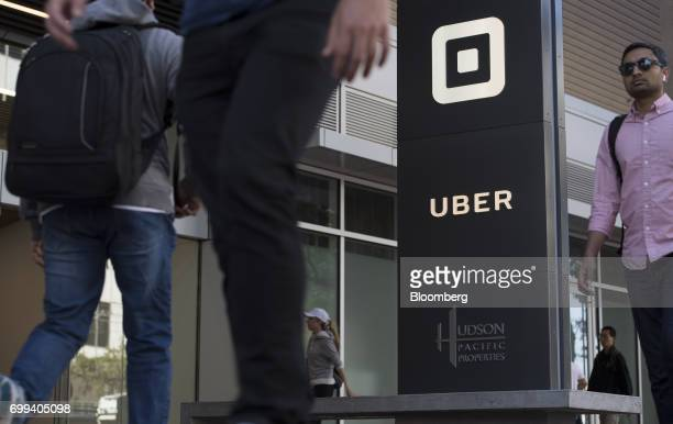Pedestrians walk past the Uber Technologies Inc headquarters building in San Francisco California US on Wednesday June 21 2017 Travis Kalanick has...