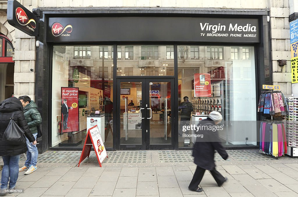 Pedestrians walk past the Virgin Media store on Oxford Street in London, U.K., on Wednesday, Feb. 6, 2013. Billionaire John Malone's Liberty Global Inc. agreed to acquire Virgin Media, Britain's second-largest pay-TV provider, in a $16 billion cash-and-stock transaction announced in the U.S. yesterday. Photographer: Chris Ratcliffe/Bloomberg via Getty Images