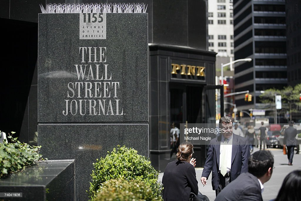 Pedestrians walk past the Wall Street Journal building at 1155 6th Avenue May 1, 2007 in New York City. Rupert Murdoch's News Corporation made an unsolicited bid of $5 billion for Dow Jones and Co., the parent company of the The Wall Street Journal.