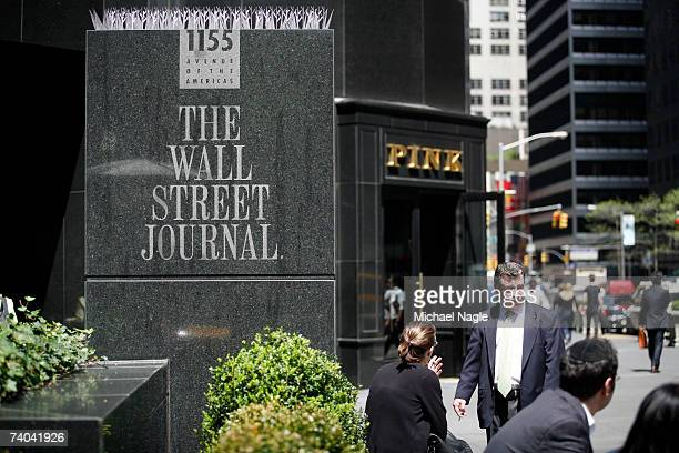 Pedestrians walk past the Wall Street Journal building at 1155 6th Avenue May 1 2007 in New York City Rupert Murdoch's News Corporation made an...