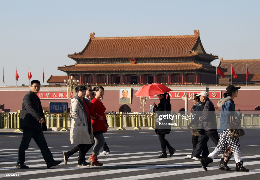 Pedestrians walk past Tiananmen Gate in Beijing, China, on Monday, March 4, 2013. Premier Wen Jiabao will this week formally announce this year's economic targets when he delivers his final work report to the National People's Congress, which begins on March 5. Photographer: Tomohiro Ohsumi/Bloomberg via Getty Images
