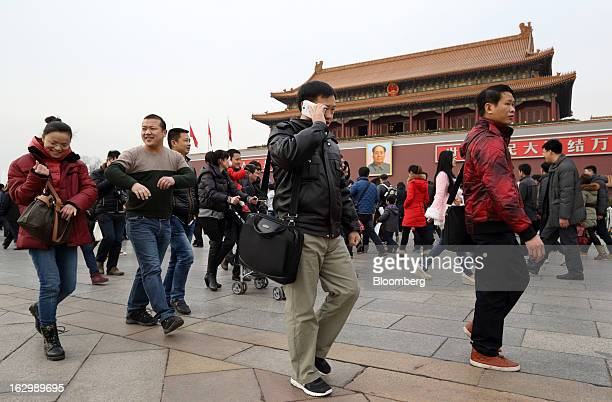 Pedestrians walk past Tiananmen Gate in Beijing China on Saturday March 2 2013 Premier Wen Jiabao will this week formally announce this year's...