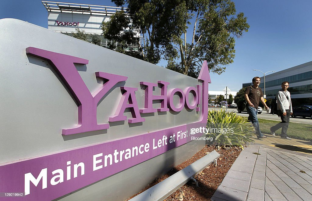 Pedestrians walk past Yahoo Inc signage displayed outside of company headquarters in Sunnyvale California US on Thursday Oct 13 2011 Anne Toth chief...