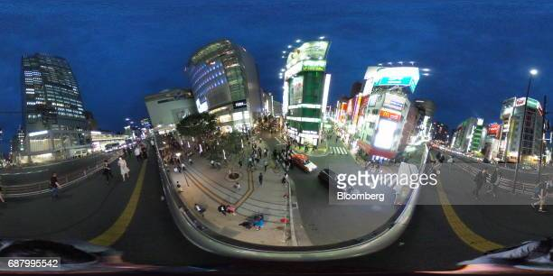 Pedestrians walk through a shopping area in the Shinjuku area of Tokyo Japan on Wednesday May 24 2017 Japan is scheduled to release Consumer Price...