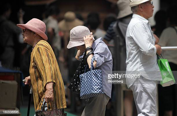 Pedestrians walk through a shopping district in Tokyo Japan on Thursday Aug 16 2012 With 7 million baby boomers starting to retire this year and...