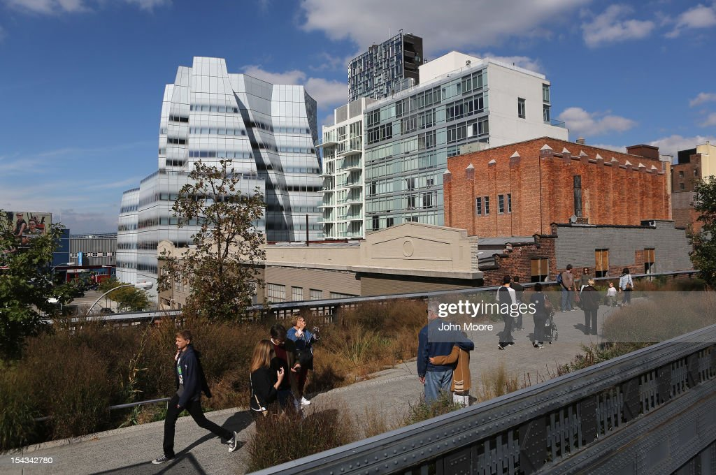 Pedestrians walk through Manhattan's High Line park near the offices of Newsweek Magazine in the Frank Gehry-designed IAC Building (L), on October 18, 2012 in New York City. Tina Brown, editor-in-chief of The Newsweek Daily Beast Co, announced today that the 80-year-old news magazine will publish its final print edition on December 31 and shift to an all-digital format in early 2013. Staff layoffs are expected.