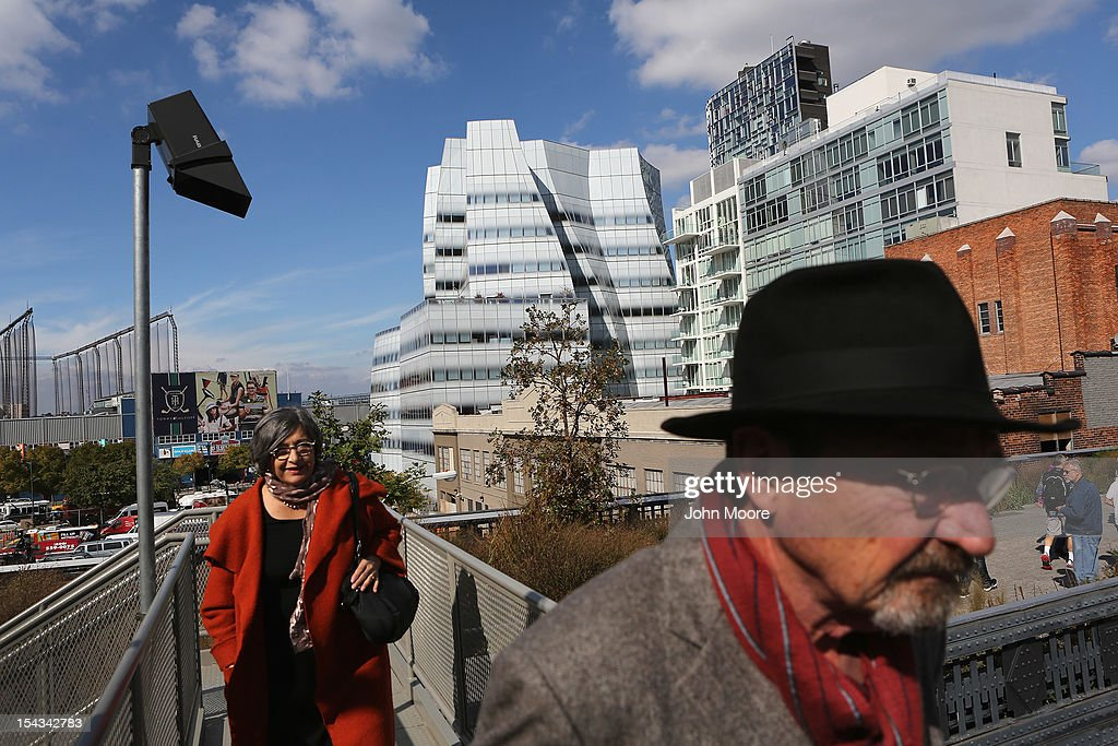 Pedestrians walk through Manhattan's High Line park near the offices of Newsweek Magazine in the Frank Gehry-designed IAC Building (C), on October 18, 2012 in New York City. Tina Brown, editor-in-chief of The Newsweek Daily Beast Co, announced today that the 80-year-old news magazine will publish its final print edition on December 31 and shift to an all-digital format in early 2013. Staff layoffs are expected.