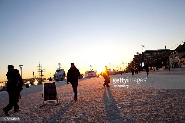 Pedestrians walk through the Aker Brygge district of Oslo Norway on Wednesday Dec 1 2010 Norwegian manufacturing expanded last month at the fastest...