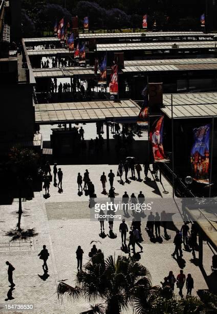 Pedestrians walk through the Circular Quay wharf complex in Sydney Australia on Tuesday Oct 23 2012 Treasurer Wayne Swan on Monday reiterated that...
