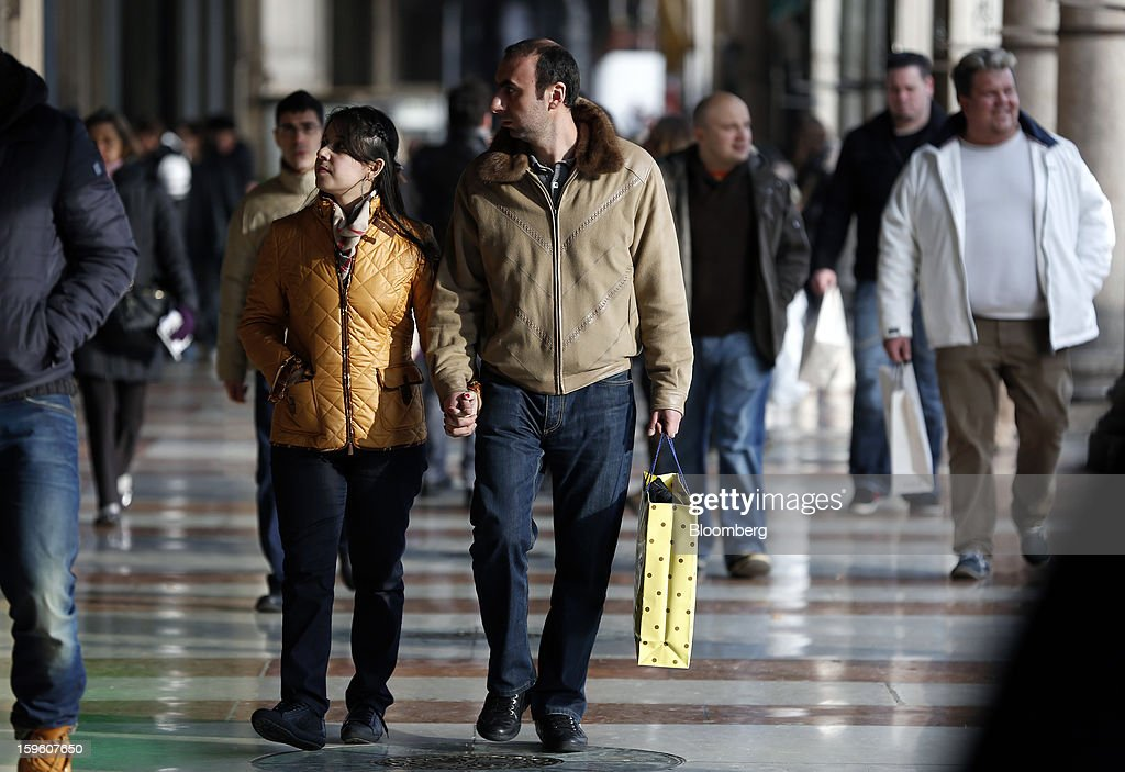 Pedestrians walk through the Galleria Vittorio Emanuele II shopping mall in Milan, Italy, on Thursday, Jan. 17, 2013. The euro-area economy won't return to growth until the next quarter as a recovery in Italy is delayed and France continues to shrink, according to a survey of economists. Photographer: Alessia Pierdomenico/Bloomberg via Getty Images