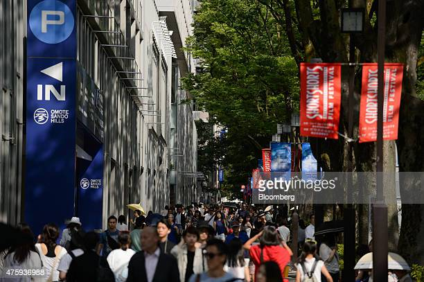 Pedestrians walk through the Omotesando area of Tokyo Japan on Monday June 1 2015 Record Japanese property lending is driving such a strong recovery...
