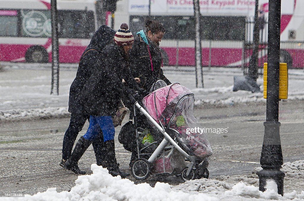Pedestrians walk through the snow in Belfast City centre in Northern Ireland, on March 22, 2013. Britain should be celebrating the start of spring but the kingdom was shivering Friday after heavy snowfall left tens of thousands of homes without power. Northern Ireland bore the brunt of the cold snap, caused by an area of low pressure moving eastwards off the Atlantic Ocean.