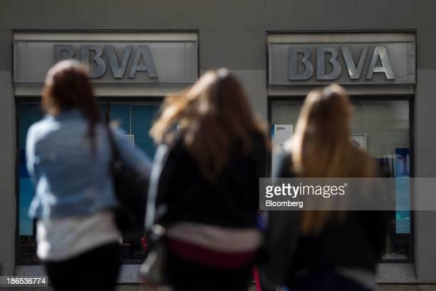 Pedestrians walk towards a Banco Bilbao Vizcaya Argentaria SA bank branch in Madrid Spain on Thursday Oct 31 2013 BBVA Spain's secondbiggest bank...