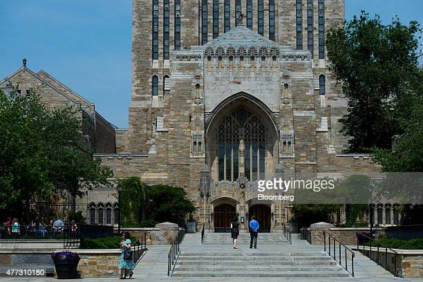 Pedestrians walk up the steps to the Sterling Memorial Library on the Yale University campus in New Haven Connecticut US on Friday June 12 2015 Yale...