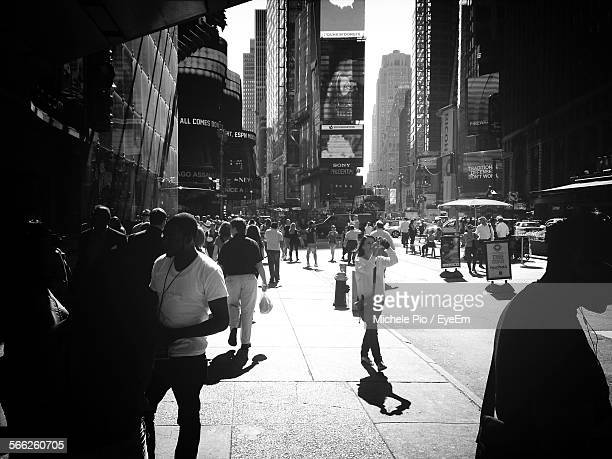 Pedestrians Walking In Times Square