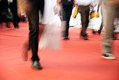 Pedestrians walking on a red carpet