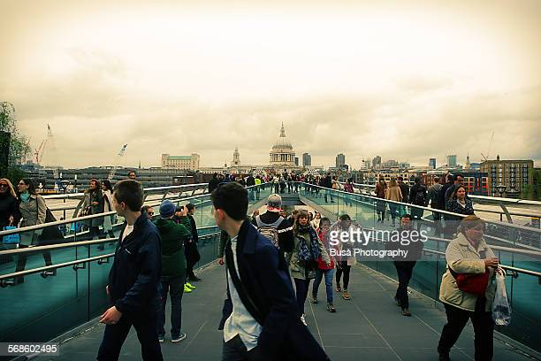 Pedestrians walking on Millenium Bridge, London