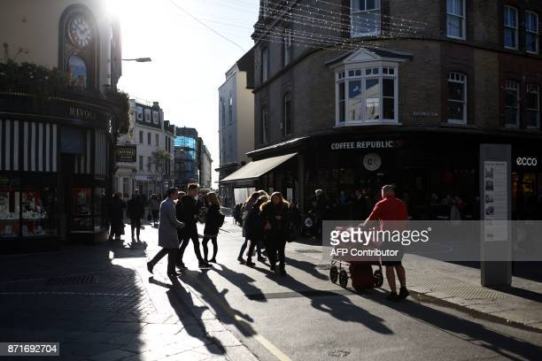 Pedestrians walks along King Street in St Helier on the British island of Jersey on November 8 2017 Jersey is a British Crown Dependency with a...