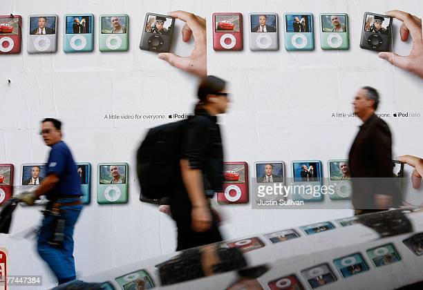 Pedestrians walks by a billboard featuring the new Apple iPod nano October 22 2007 in San Francisco California Apple stock surged $394 to close at a...