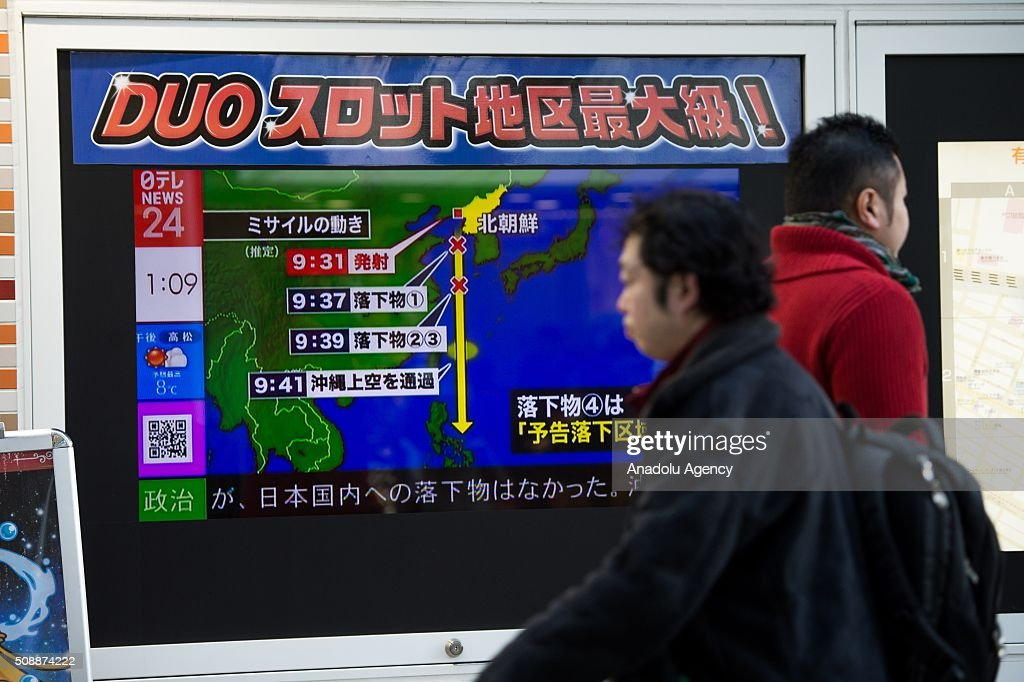 Pedestrians walks front a news channel's screen in Tokyo, Japan which report about North Korea's rocket launch on February 7, 2016. North Korea launched a long-range rocket on February 7, violating UN resolutions and doubling down against an international community already determined to punish Pyongyang for a nuclear test last month.