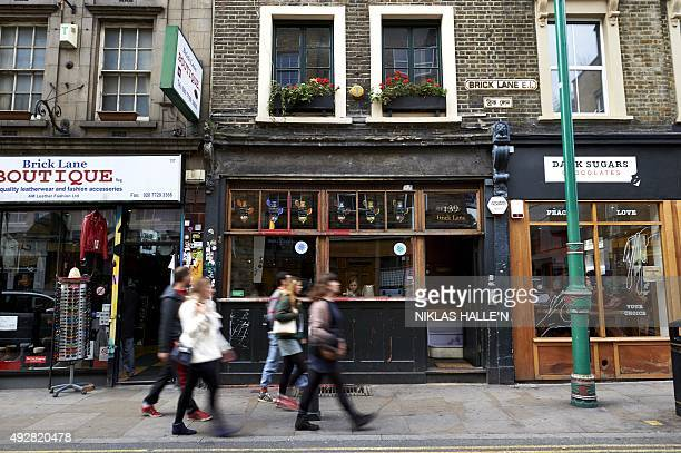Pedestrians walks past the Cereal Killer Cafe on Brick Lane in Shoreditch east London on October 12 2015 When two bearded brothers from Belfast...