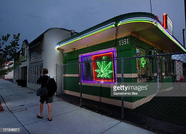 A pedestrians walks past the Little Green Pharmacy medical cannabis dispensary in Denver Colorado on Tuesday August 2 2011