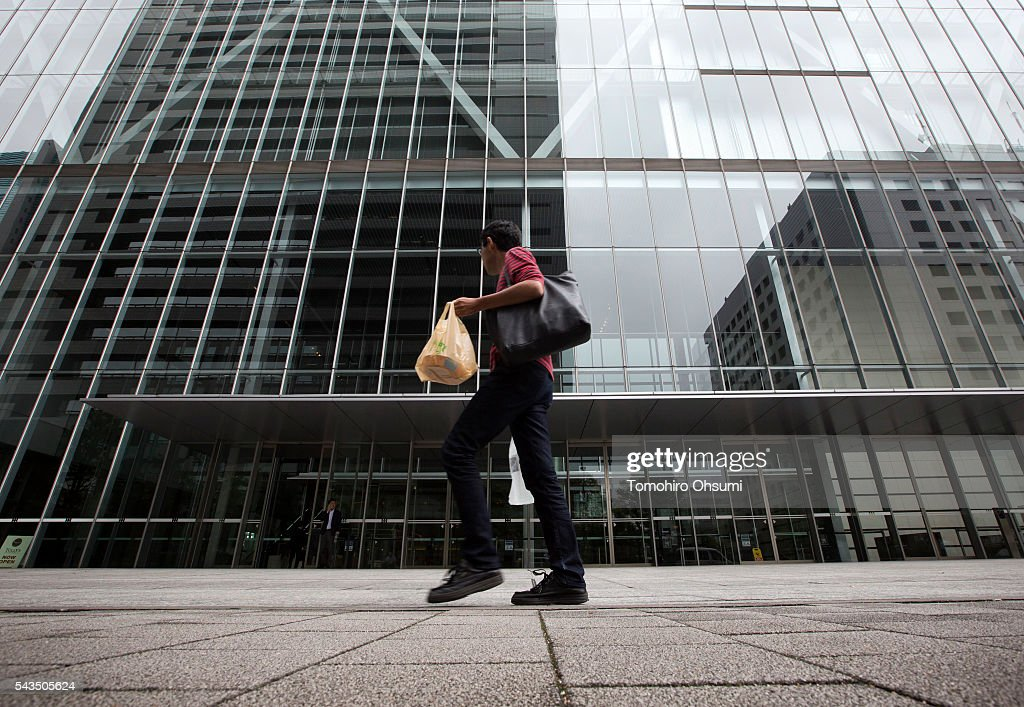 A pedestrians walks past the Sony Corp. headquarters on June 29, 2016 in Tokyo, Japan. Sony announced its mid-range business strategy plan from FY2015 through 2017 today.