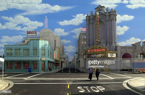 Pedestrians walks through a replica of Hollywood's famous ''Hollywood and Vine'' intersection on a movie ''backlot'' at Disney's California Adventure...