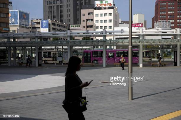 A pedetsrian is silhouetted as she walks past a bus station in Fukui Japan on Wednesday Oct 11 2017 Fukui Prefecture has one of the lowest rates of...